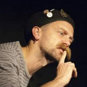 Picture of Jonny Fluffypunk, with hat and large moustache